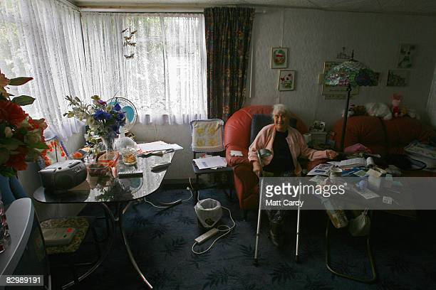Pamella Clifton sits in a chair inside her prefab house in Catford on September 24 2008 in London England Pamella has lived in her home since 1962...