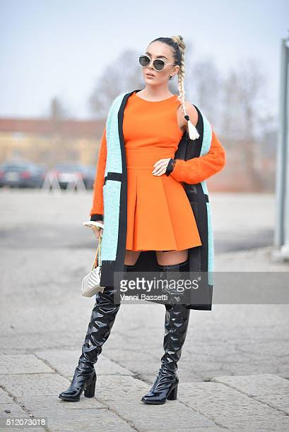 Pamella Ferrari poses wearing Fausto Puglisi coat and dress and YSL bag before the Gucci show during the Milan Fashion Week Fall/Winter 2016/17 on...