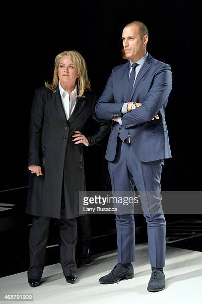 Pamella Roland and Nigel Barker observe the rehearsal before the Pamella Roland fashion show during MercedesBenz Fashion Week Fall 2014 at The Salon...