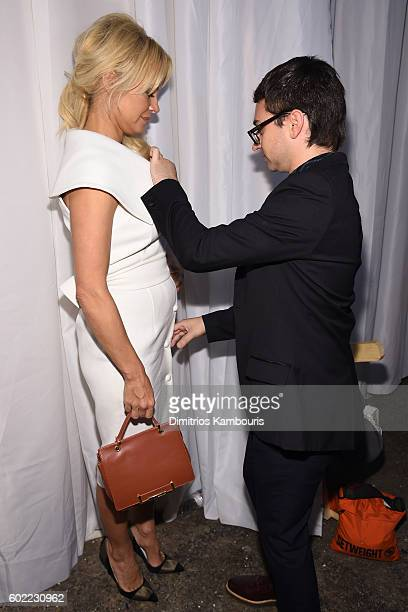 Pamerla Anderson and Christian Siriano pose backstage at the Christian Siriano fashion show during New York Fashion Week The Shows at ArtBeam on...
