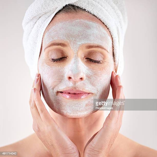 Pampering her skin with a facial treatment