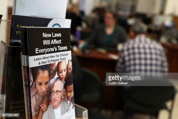 A pamphlet about the new tax laws is displayed at Liberty Tax Service tax on April 16 2018 in Oakland California Taxpayers who have procrastinated on...