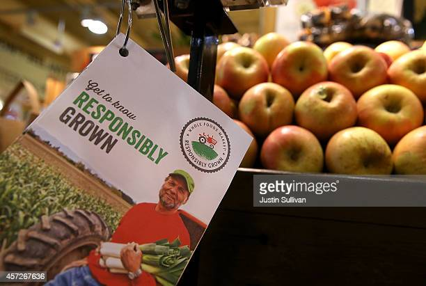 A pamphlet advertising the new Responsibly Grown program is displayed in the produce section at a Whole Foods market on October 15 2014 in San...
