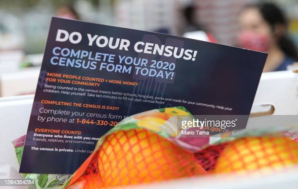 A pamphlet with 2020 census information is included in a box of food to be distributed by the Los Angeles Regional Food Bank to people facing...
