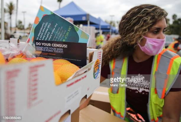 Pamphlet with 2020 census information is included in a box of food to be distributed by the Los Angeles Regional Food Bank to people facing economic...