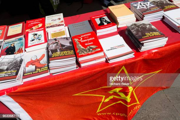 Pamphlets and literature on a stall of the Communist Party of Great Britain gather in Trafalgar Square during the traditional May Day celebrations in...