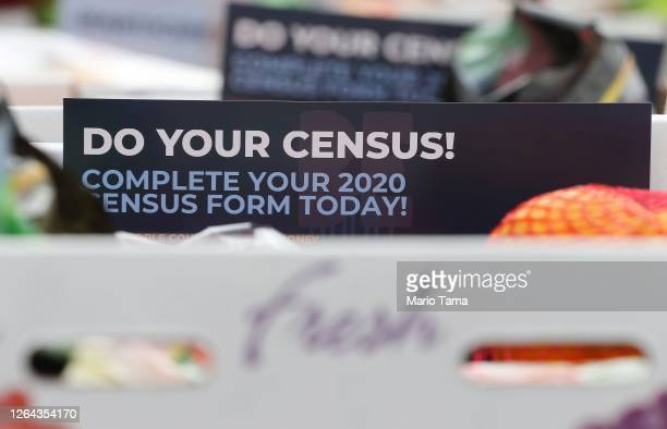 Pamphlets with 2020 census information are included in boxes of food to be distributed by the Los Angeles Regional Food Bank to people facing...