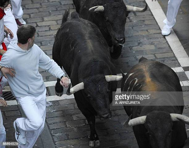 Participants run with Jose Cebada Gago fighting bulls on the second day of the San Fermin bull run on July 8 in Pamplona northern Spain On each day...