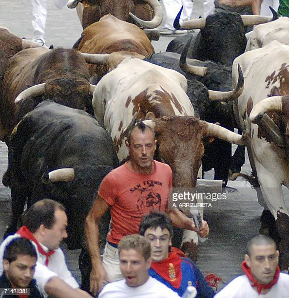 Alcurrucen fighting bulls chase revellers during the sixth encierro of the San Fermin festivities 12 July 2006 in Pamplona northern Spain AFP PHOTO /...