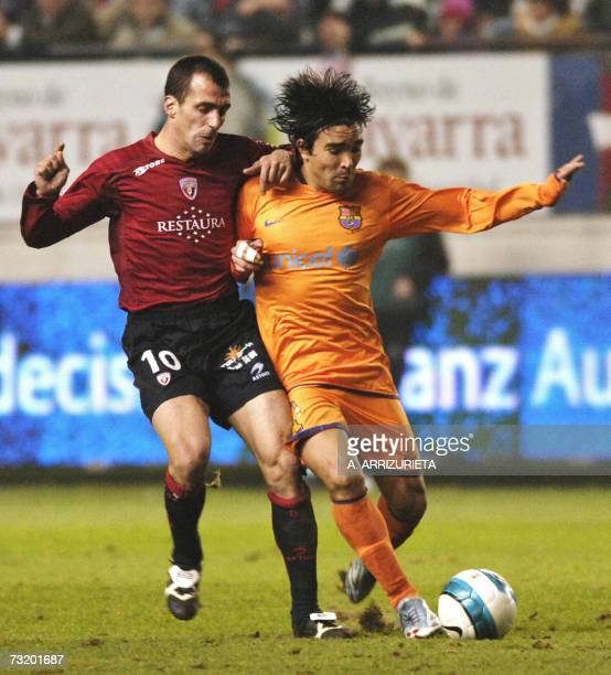 Barcelona's Brazilian player Anderson Luis de Souza fights for the ball with Osasuna's Francisco Pual during their Spanish league football match 04...