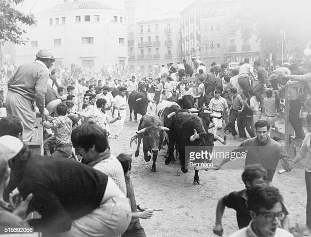 Pamplona, Spain: Big Bullies. A stampede? Not quite. It's the traditional running of the bulls, which fascinated among others, the late Ernest...