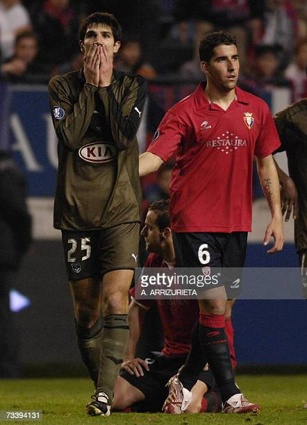 Bordeaux's Cid gestures after missing a shot on goal by Osasuna's Raul Garcia during a UEFA Cup return leg football match in Pamplona 22 February...