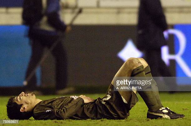 Bordeaux's Cid lies on the ground after losing 10 to Osasuna during a UEFA Cup return leg football match in Pamplona 22 February 2007 AFP PHOTO/A...