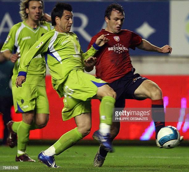 Getafe's David Sousa and Osasuna's Bernardo Romeo tussle for the ball during a King's Cup football match at the Reyno de Navarra Stadium in Pamplona...