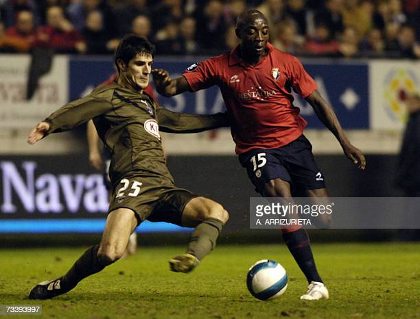 Osasuna's Achille Webo is tackled by Bordeaux's Cid during a UEFA Cup return leg football match in Pamplona 22 February 2007 Osasuna won 10 AFP...