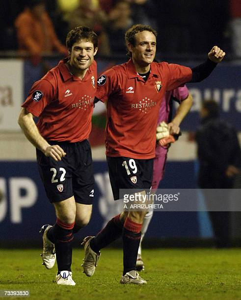 Osasuna's Inaki Munoz and Corrales celebrate after beating Bordeaux 10 during a UEFA Cup return leg football match in Pamplona 22 February 2007 AFP...