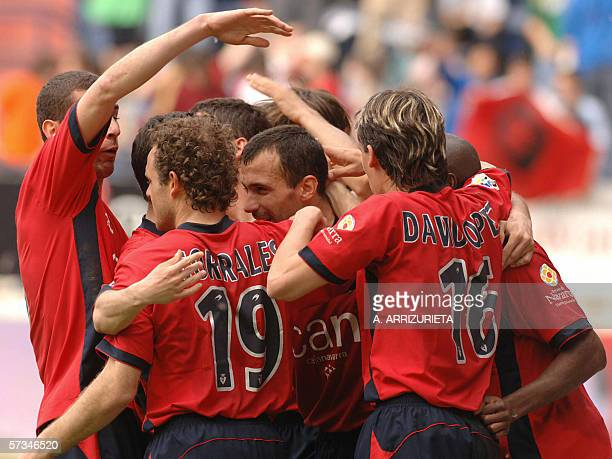 Osasuna's Patxi Punal is congratuled by teammates after scoring against Malaga 16 April 2006 during a Spanish league football match at the Reyno de...