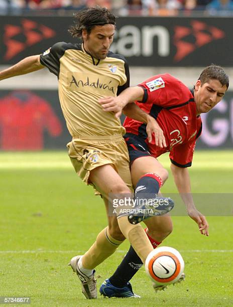 Osasuna's Raul Garcia fights for the ball with Malaga's Juan Antonio Rodriguez 16 April 2006 during a Spanish league football match at the Reyno de...