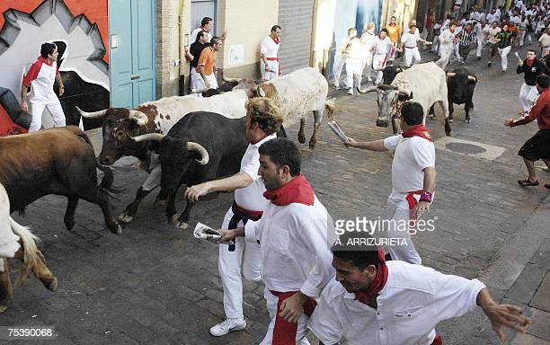 Participants run with Antonio Banuelos fighting bulls during the seventh encierro of the San Fermin festivities 13 July 2007 in Pamplona northern...