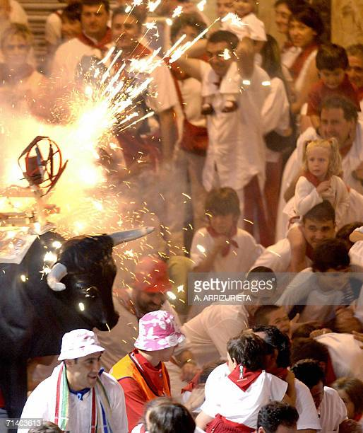 People run in front of the Bull of Fire in Estafeta street during the San Fermin festivities in the northern Spanish city of Pamplona 09 July 2005...