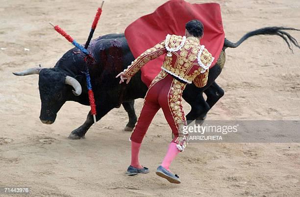 Spanish matador Jose Lirira Fernndez 'Pepn Liria' performs a pass on a Victorino Martin fighting bull 14 July 2006 during the last corrida of the San...