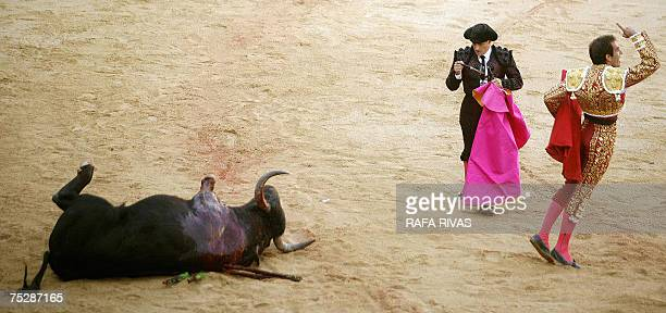 Spanish matador Salvador Cortes reacts after killing his first Fuente Ymbro fighting bull with a sword during the third corrida of the San Fermin...
