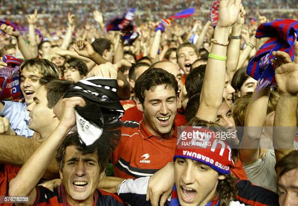 Supporters of Osasuna celebrate after their team won 21 against Valencia and qualified for Champions League 16 May 2006 during a Spanish league...
