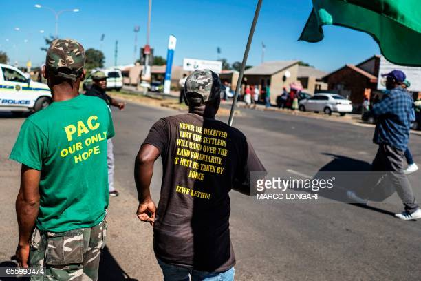 Pan African Congress activists march as they commemorate the Sharpeville massacre anniversary at the Phelandaba in Sharpeville in the Transvaal on...