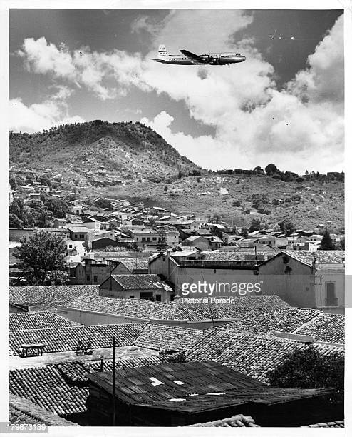 A Pan Am airplane gets ready to land in Tegucigalpa Honduras surrounded by a mountain range