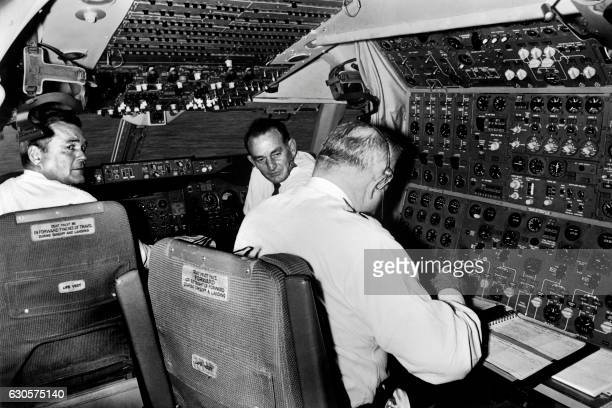 Pan American Airways pilots are seen in the cockpit of the Boeing 747 at London Heathrow airport on January 22 1970 after its first commercial flight...