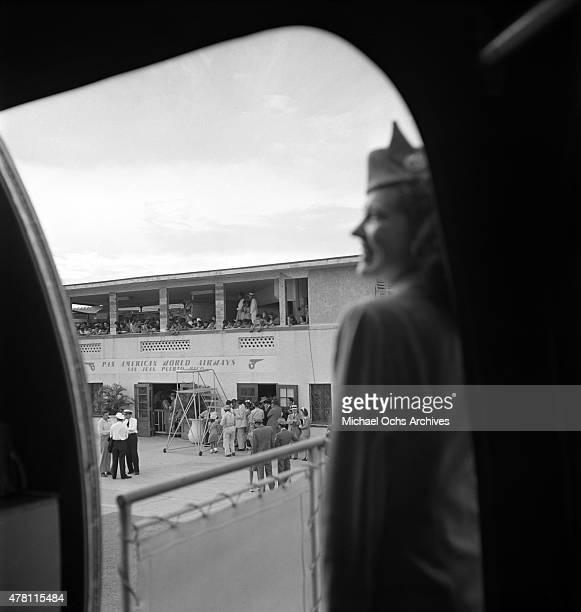 Pan American Airways Stewardess greets boarding passengers circa 1947 in San Juan Puerto Rico