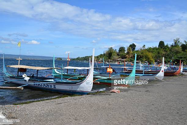 pan boats at volcano island, lake taal philippines - taal volcano stock photos and pictures