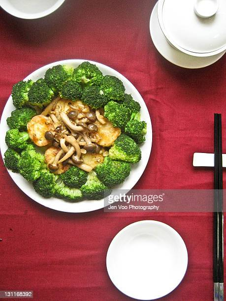 pan fried egg tofu with shimeji mushrooms in abalo - shimeji mushroom stock pictures, royalty-free photos & images