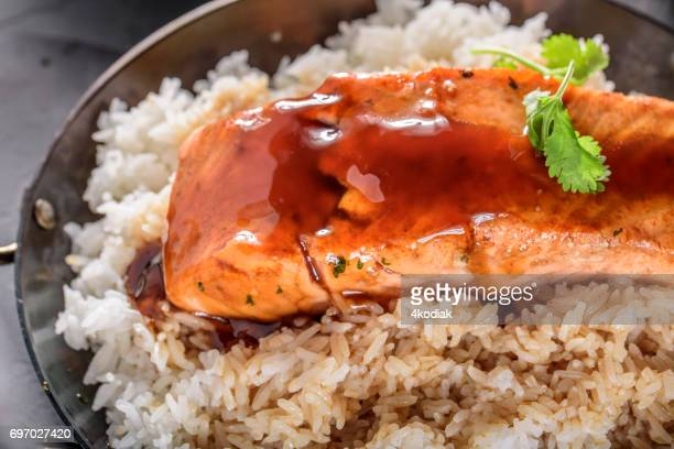 pan fried salmon steak with teriyaki sauce over rice - soy sauce stock photos and pictures