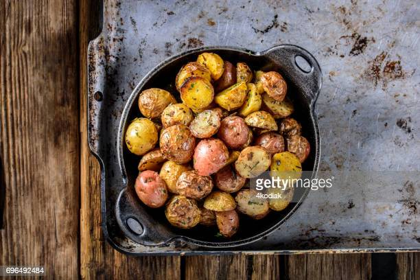 pan fried yukon gold potatoes with herb in cast iron - raw potato stock pictures, royalty-free photos & images