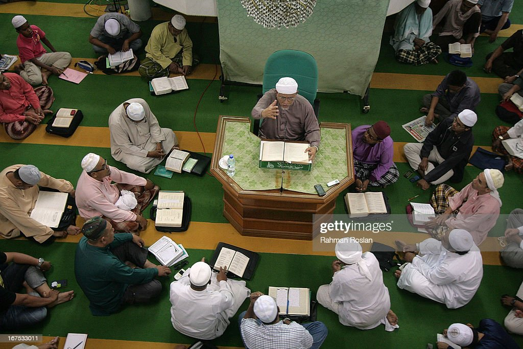 Pan Islamic Party president Abdul Hadi Awang holds a weekly Friday sermon on April 26, 2013 in Rusila, Malaysia. Malaysia's 13th general election will be held on May 5.