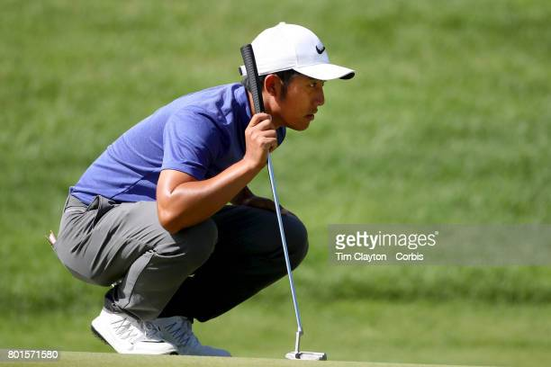CT Pan of Chinese Taipei lines up a putt on the ninth during the third round of the Travelers Championship Tournament at the TPC River Highlands Golf...
