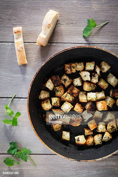 pan of croutons with herbs - crouton stock photos and pictures