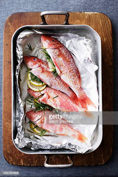 Pan of mullet fish with lemon and herbs