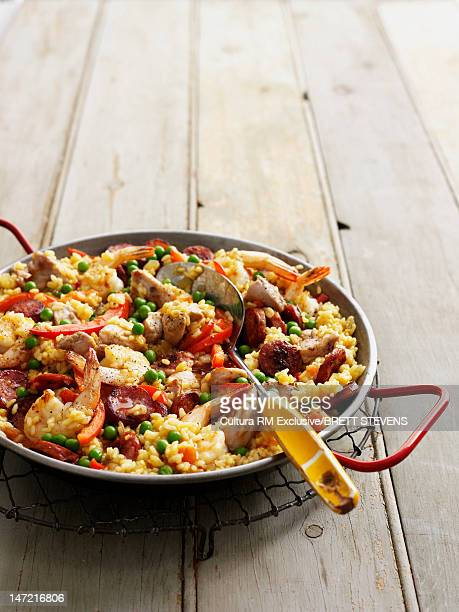 Pan of paella on wooden table