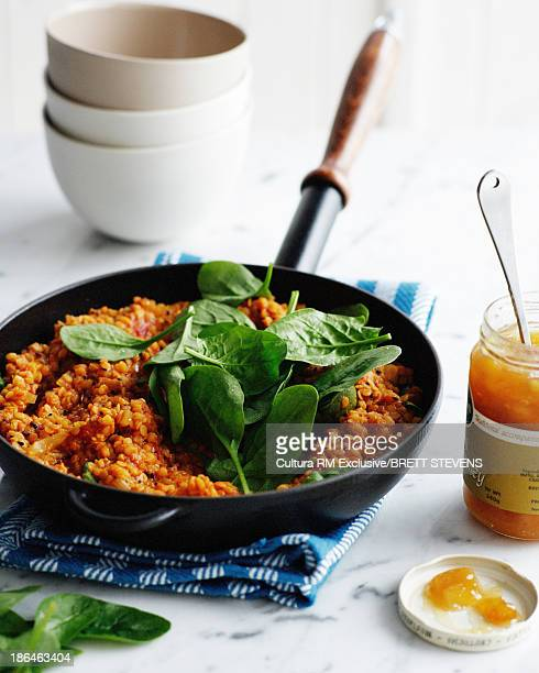 Pan of spiced dahl with jar of mango chutney