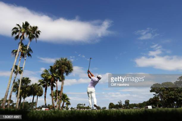 Pan of Taiwan plays his shot from the ninth tee during the final round of The Honda Classic at PGA National Champion course on March 21, 2021 in Palm...