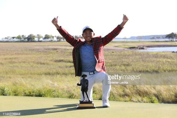 T Pan of Taiwan poses with the trophy after winning the 2019 RBC Heritage at Harbour Town Golf Links on April 21 2019 in Hilton Head Island South...