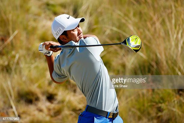 T Pan of Taiwan watches his tee shot on the sixth hole during the second round of the 115th US Open Championship at Chambers Bay on June 19 2015 in...