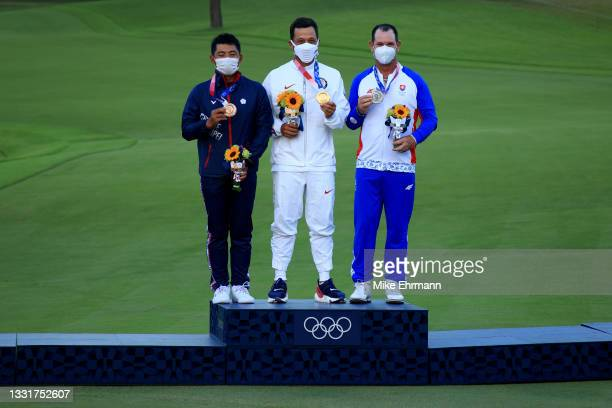 Pan of Team Chinese Taipei celebrates with the bronze medal, Xander Schauffele of Team United States with the gold medal and Rory Sabbatini of Team...