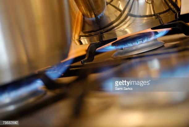 Pan on gas hob, close-up (tilt)