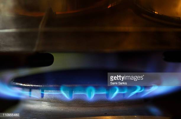 Pan on lit blue gas ring, close-up