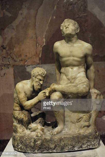 Pan pulling a thorn from the foot of a faun Roman copy of Greek original from 3rd century BC Statuary group Marble The State Hermitage Museum Saint...