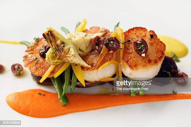 Pan Seared Diver Scallops, Roasted Red and Yellow Pepper Coulis with Roasted Artichoke, Haricot Vert and Nicoisse Olives at Marcel's Sunday brunch...