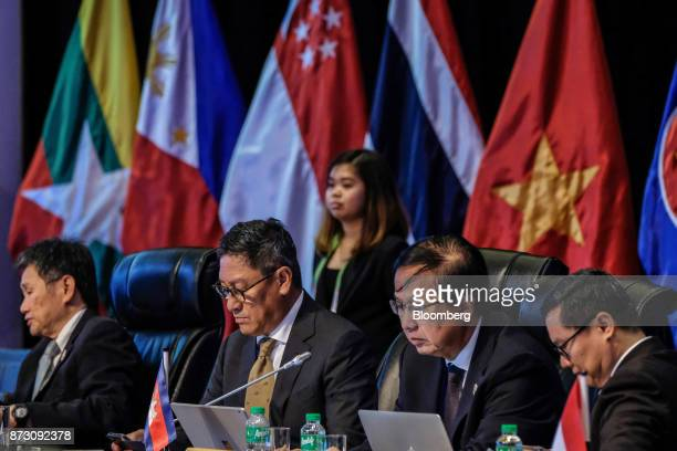 Pan Sorasak Cambodia's minister of commerce second right attends the Asean economic council meeting at the Association of Southeast Asian Nations...
